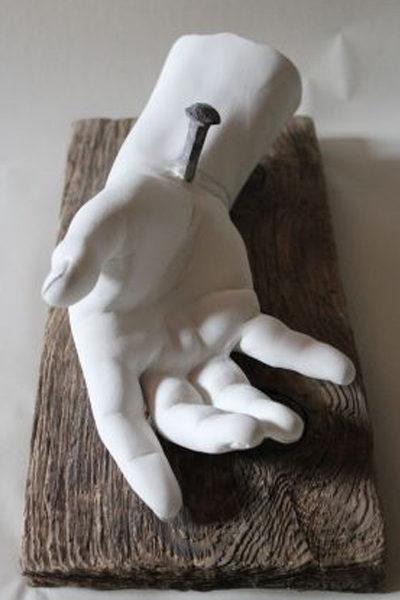 Hand Jesu auf einem Brett