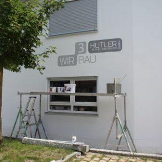 Raumgestaltung: Wandbemalung mit Firmenlogo